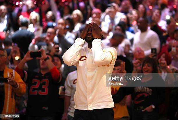 LeBron James of the Cleveland Cavaliers reacts during the championship banner raising and ring ceremony before the game against the New York Knicks...