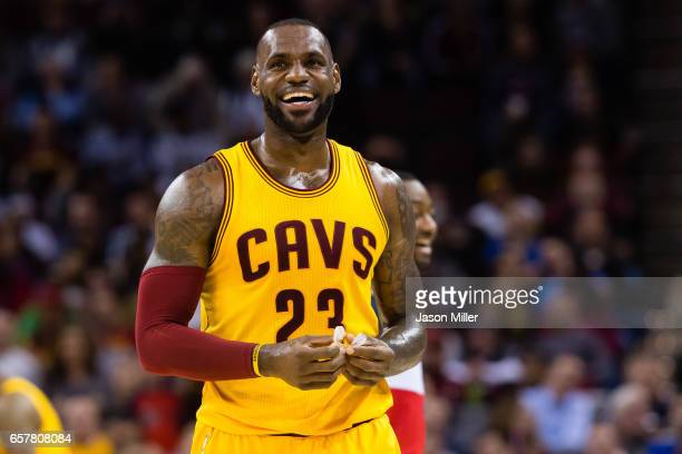 LeBron James of the Cleveland Cavaliers reacts during the first half against the Washington Wizards at Quicken Loans Arena on March 25 2017 in...