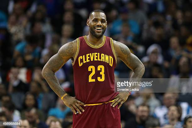 LeBron James of the Cleveland Cavaliers reacts during their game against the Charlotte Hornets at Time Warner Cable Arena on November 27 2015 in...