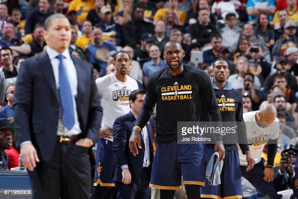 LeBron James of the Cleveland Cavaliers reacts from the bench against the Indiana Pacers in the second half of Game Four of the Eastern Conference...