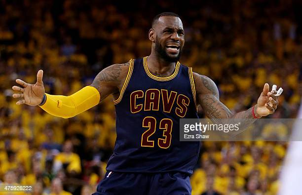LeBron James of the Cleveland Cavaliers reacts in the second half against the Golden State Warriors during Game One of the 2015 NBA Finals at ORACLE...
