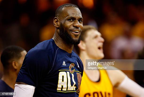 LeBron James of the Cleveland Cavaliers reacts on the bench in the fourth quarter against the Atlanta Hawks during Game Four of the Eastern...