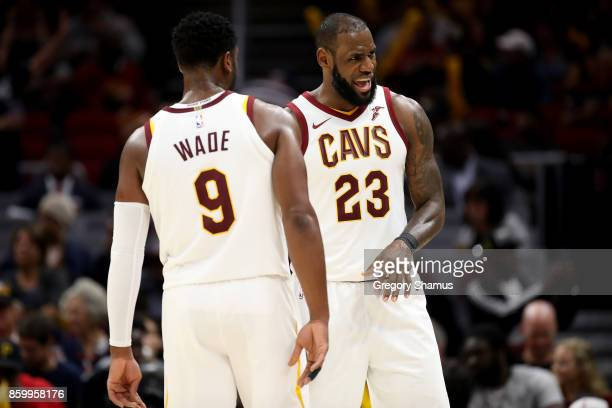 LeBron James of the Cleveland Cavaliers reacts to a foul cal with Dwyane Wade while playing the Chicago Bulls during a pre season game at Quicken...