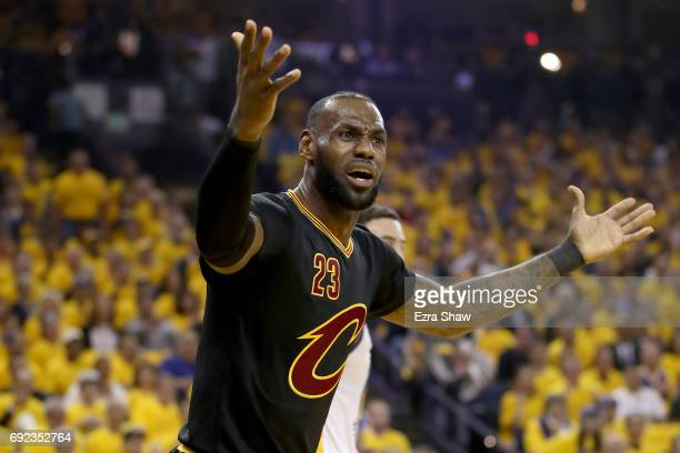 LeBron James of the Cleveland Cavaliers reacts to a play against the Golden State Warriors in Game 2 of the 2017 NBA Finals at ORACLE Arena on June 4...