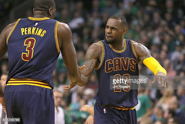 LeBron James of the Cleveland Cavaliers reacts with Kendrick Perkins against Boston Celtics after the second quarter in Game Four during the first...
