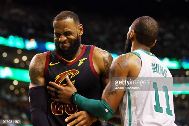 Lebron James of the Cleveland Cavaliers reacts with Kyrie Irving of the Boston Celtics during the first quarter of a game at TD Garden on February 11...