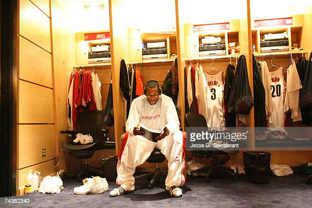 Lebron James of the Cleveland Cavaliers reads at his locker prior to Game Six of the Eastern Conference Finals against the Detroit Pistons during the...