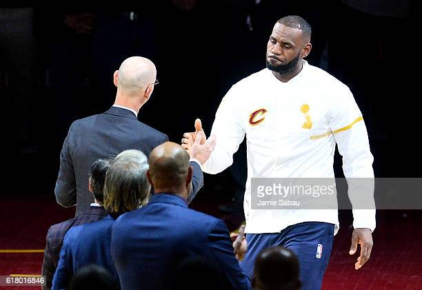 LeBron James of the Cleveland Cavaliers receives his championship ring from NBA commissioner Adam Silver before the game against the New York Knicks...