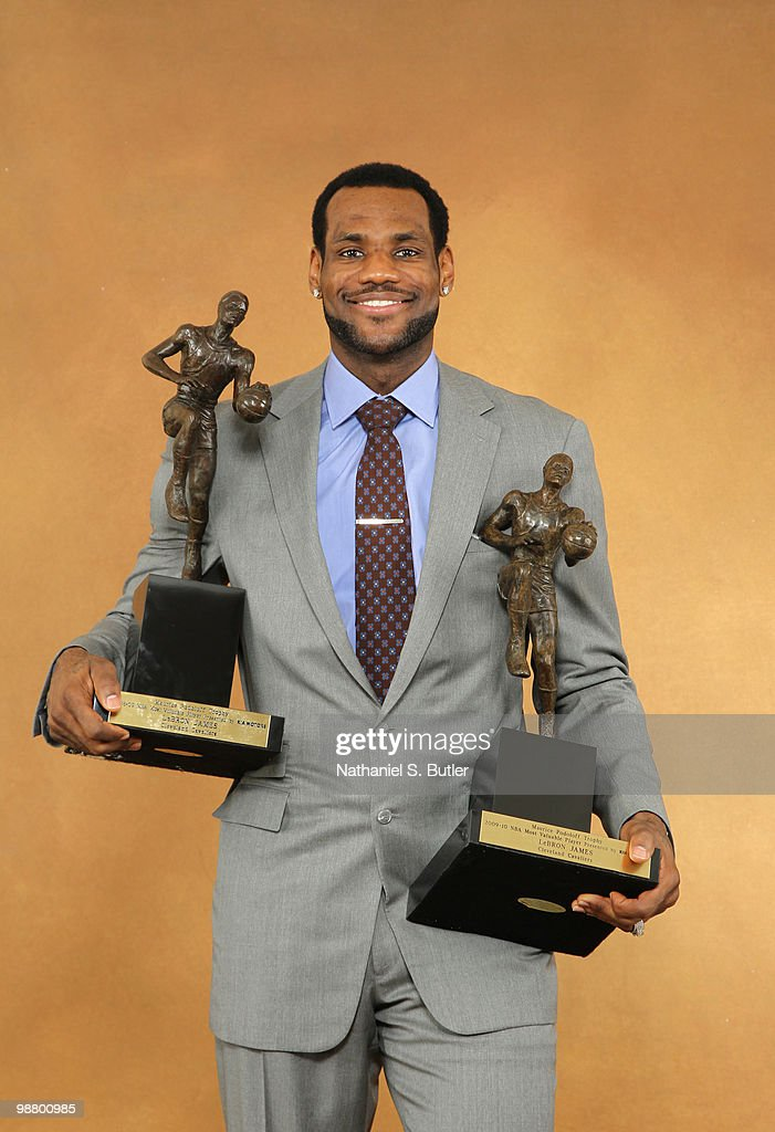 LeBron James Of The Cleveland Cavaliers Receives Maurice Podoloff Trophy As 2009 10