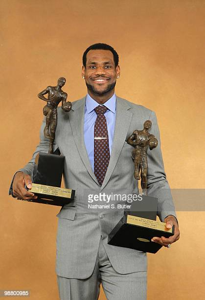LeBron James of the Cleveland Cavaliers receives the Maurice Podoloff Trophy as the 200910 NBA Most Valuable Player presented by Kia Motors on May 2...