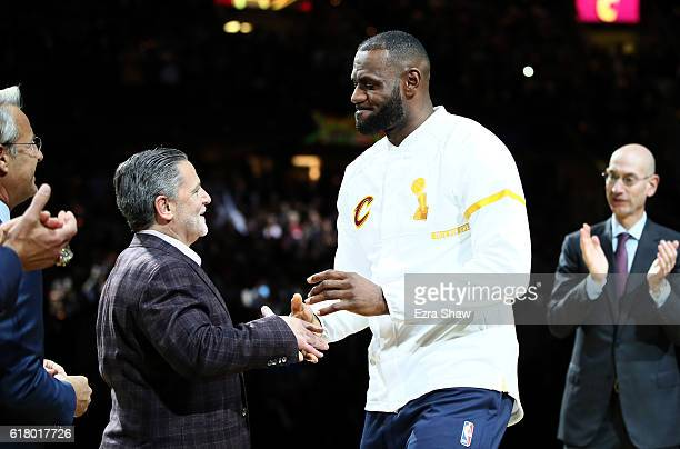 LeBron James of the Cleveland Cavaliers recieves his championship ring from owner Dan Gilbert before the game against the New York Knicks at Quicken...