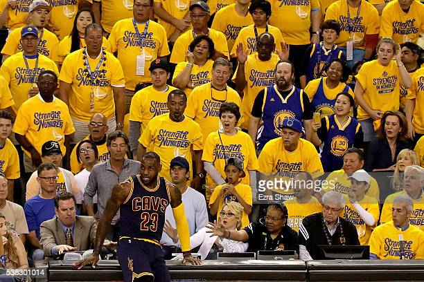 LeBron James of the Cleveland Cavaliers runs in to the scorers table in Game 2 of the 2016 NBA Finals against the Golden State Warriors at ORACLE...