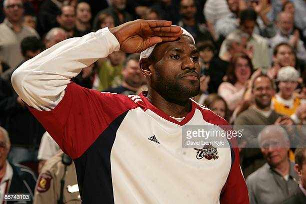 LeBron James of the Cleveland Cavaliers salutes following the National Anthem before the game against the Detroit Pistons at The Quicken Loans Arena...