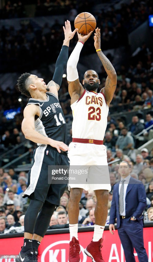 LeBron James #23 of the Cleveland Cavaliers scores his 30,001 point over Danny Green #14 of the San Antonio Spurs at AT&T Center on January 23, 2018 in San Antonio, Texas.