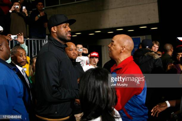 LeBron James of the Cleveland Cavaliers shakes hands with Harlem Globetrotters legend Fred Curly Neal during the 2010 NBA AllStar Celebrity Game...