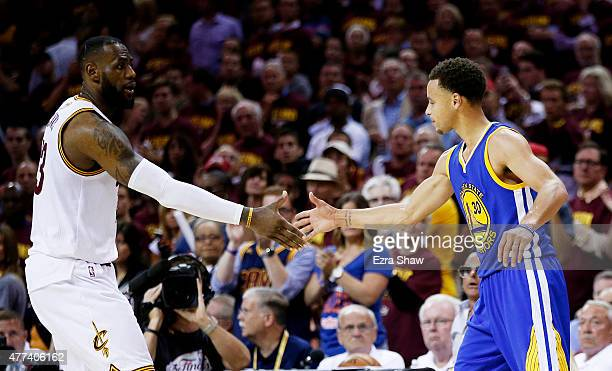 LeBron James of the Cleveland Cavaliers shakes hands with Stephen Curry of the Golden State Warriors after the Warriors defeated the Cavs 105 to 97...