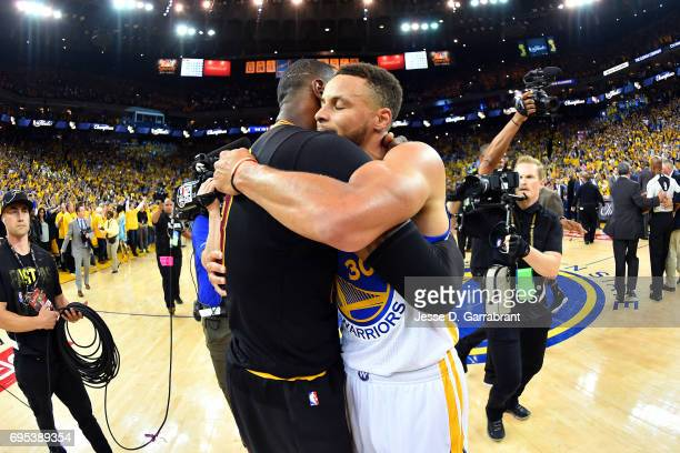 LeBron James of the Cleveland Cavaliers shares a hug with Stephen Curry of the Golden State Warriors in Game Five of the 2017 NBA Finals on June 12...