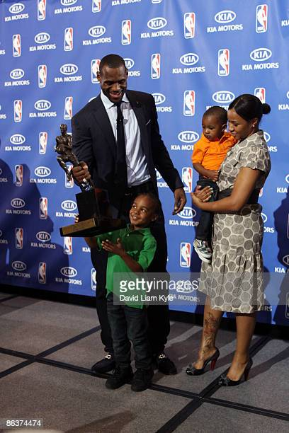 LeBron James of the Cleveland Cavaliers shares the stage with sons LeBron Jr and Bryce and their mother Savannah Brinson after he was named the NBA...