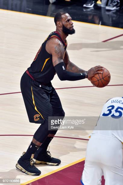 OH LeBron James of the Cleveland Cavaliers shoots a free throw during the game against the Golden State Warriors in Game Four of the 2018 NBA Finals...