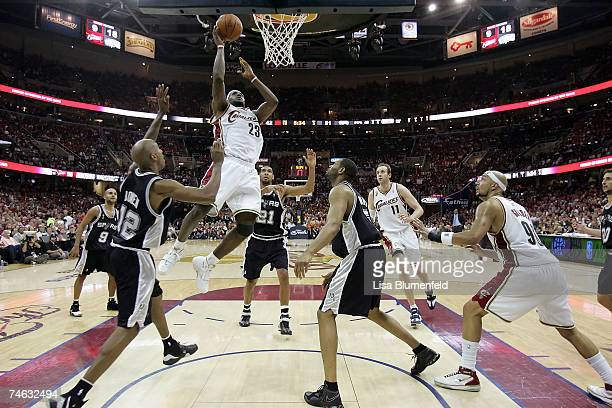 LeBron James of the Cleveland Cavaliers shoots a layup against Bruce Bowen of the San Antonio Spurs in Game Four of the NBA Finals on June 14 2007 at...