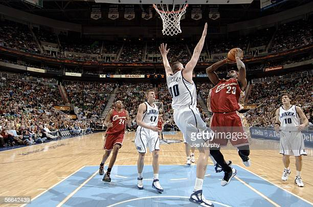 Lebron James of the Cleveland Cavaliers shoots a layup over Greg Ostertag of the Utah Jazz during a game between the Cleveland Cavaliers and Utah...