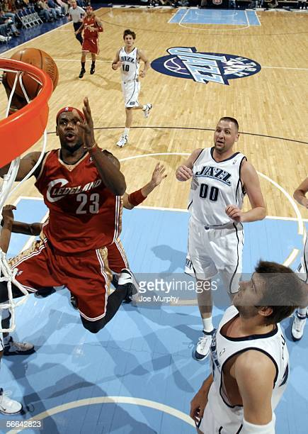 Lebron James of the Cleveland Cavaliers shoots a layup past Greg Ostertag of the Utah Jazz during a game January 21 2006 at the Delta Center in Salt...