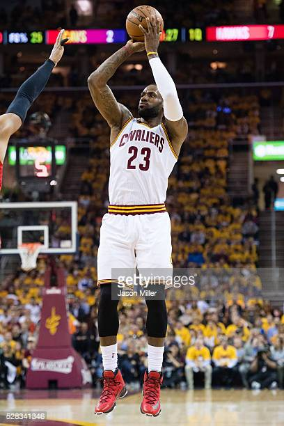 LeBron James of the Cleveland Cavaliers shoots a three point jump shot during the first half of the NBA Eastern Conference semifinals against the...