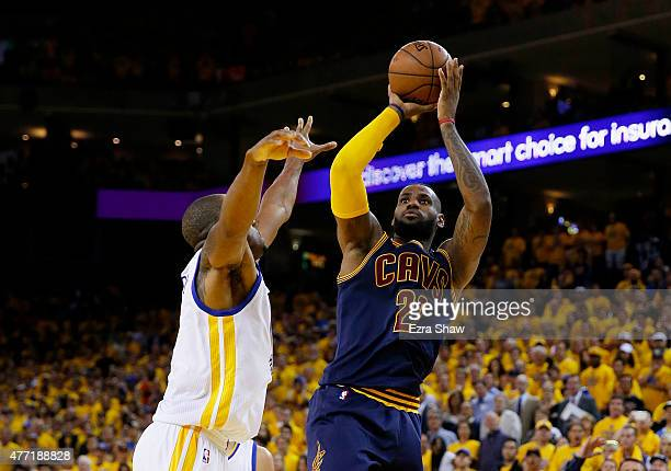 LeBron James of the Cleveland Cavaliers shoots against Andre Iguodala of the Golden State Warriors in the second half during Game Five of the 2015...