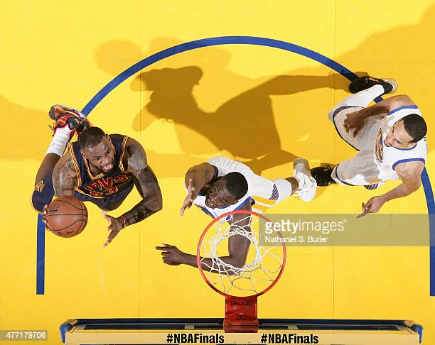 LeBron James of the Cleveland Cavaliers shoots against Draymond Green of the Golden State Warriors in Game Five of the 2015 NBA Finals on June 14...