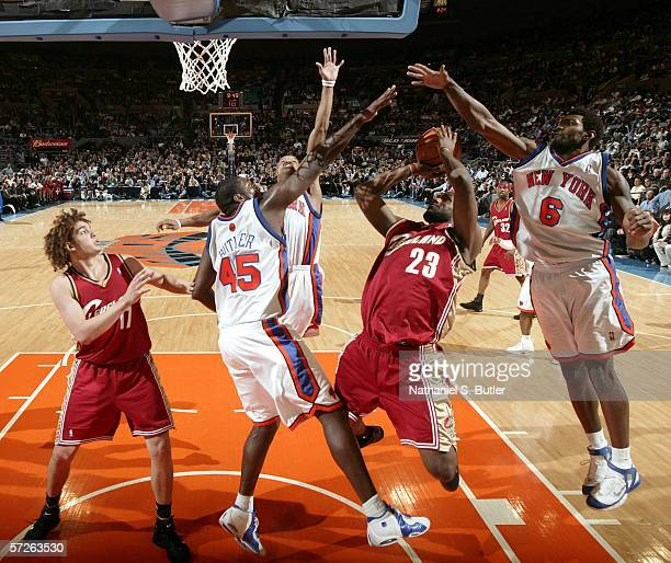 LeBron James of the Cleveland Cavaliers shoots against Jackie Butler and Qyntel Woods of the New York Knicks at Madison Square Garden on April 5 2006...