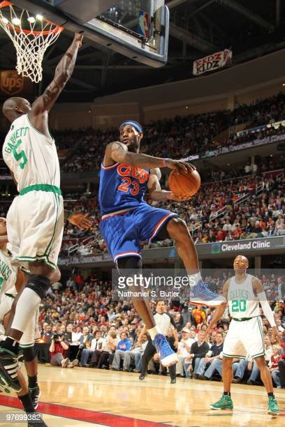LeBron James of the Cleveland Cavaliers shoots against Kevin Garnett of the Boston Celtics on March 14 2010 at Quicken Loans Arena in Cleveland Ohio...