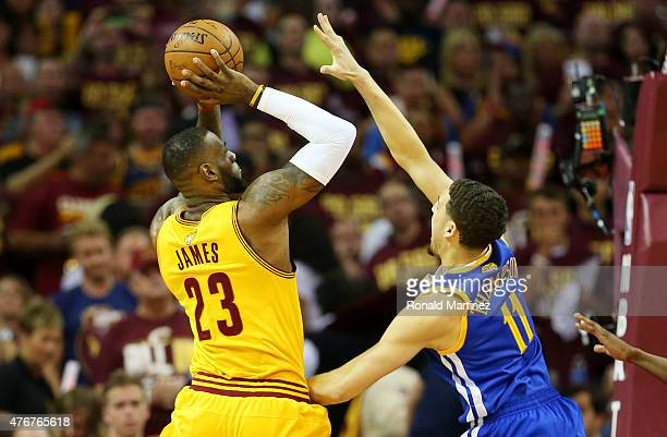 LeBron James of the Cleveland Cavaliers shoots against Klay Thompson of the Golden State Warriors in the first quarter during Game Four of the 2015...