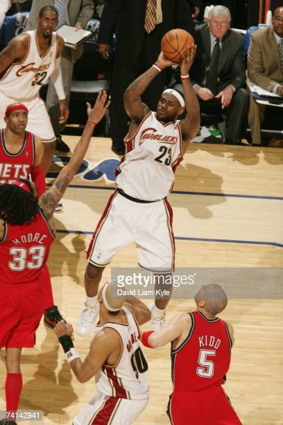 LeBron James of the Cleveland Cavaliers shoots against Mikki Moore of the New Jersey Nets in Game Two of the Eastern Conference Quarterfinals during...