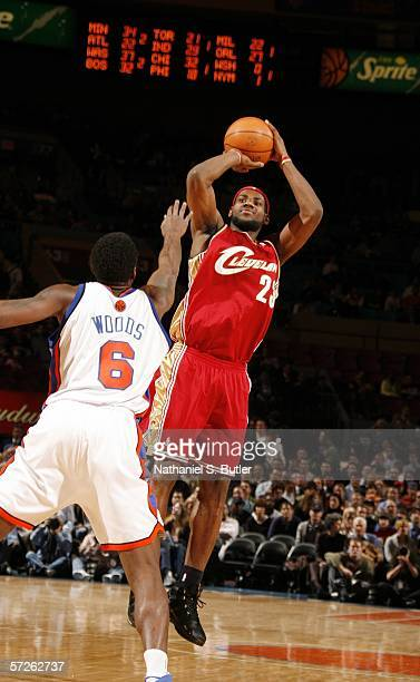 LeBron James of the Cleveland Cavaliers shoots against Qyntel Woods of the New York Knicks at Madison Square Garden on April 5 2006 in New York City...