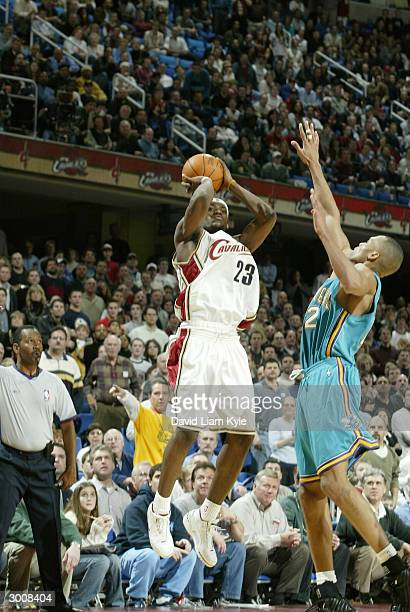 LeBron James of the Cleveland Cavaliers shoots against the New Orleans Hornets on February 23 2004 at Gund Arena in Cleveland Ohio NOTE TO USER User...