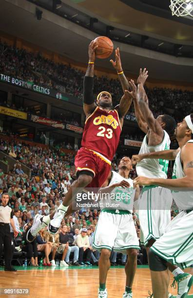 LeBron James of the Cleveland Cavaliers shoots against Tony Allen and Ray Allen of the Boston Celtics in Game Three of the Eastern Conference...