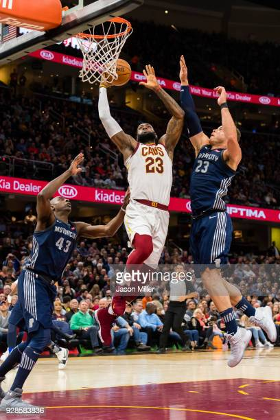 LeBron James of the Cleveland Cavaliers shoots over Blake Griffin and Anthony Tolliver of the Detroit Pistons during the second half at Quicken Loans...
