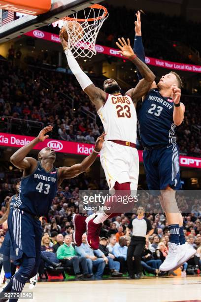 LeBron James of the Cleveland Cavaliers shoots over Blake Griffin of the Detroit Pistons during the second half at Quicken Loans Arena on March 5...