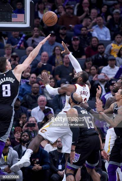 LeBron James of the Cleveland Cavaliers shoots over Bogdan Bogdanovic of the Sacramento Kings during their NBA basketball game at Golden 1 Center on...