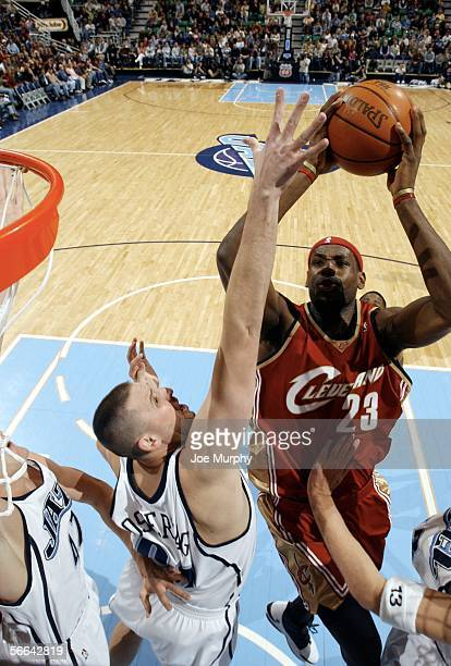 Lebron James of the Cleveland Cavaliers shoots over Greg Ostertag of the Utah Jazz during a game January 21 2006 at the Delta Center in Salt Lake...