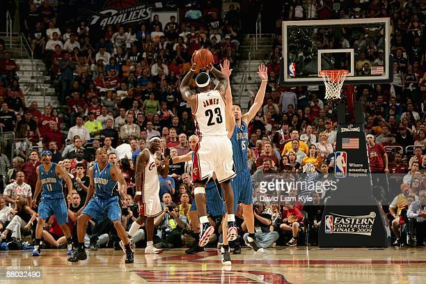 LeBron James of the Cleveland Cavaliers shoots over Hedo Turkoglu the Orlando Magic in the final seconds of Game Two of the Eastern Conference Finals...