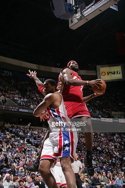 LeBron James of the Cleveland Cavaliers shoots over Jason Collins of the New Jersey Nets during the game at Continental Airlines Arena on April 8,...
