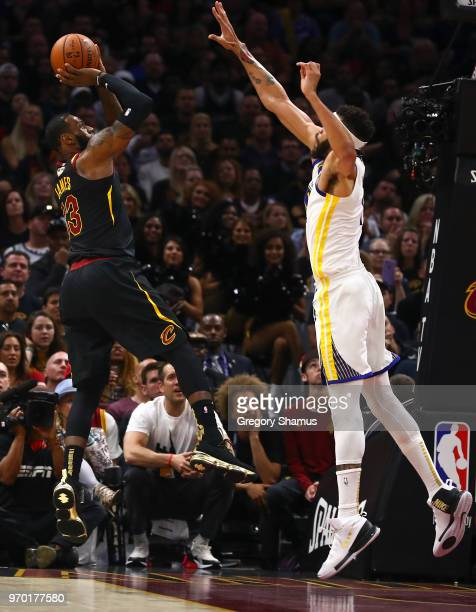 LeBron James of the Cleveland Cavaliers shoots over JaVale McGee of the Golden State Warriors in the first half during Game Four of the 2018 NBA...