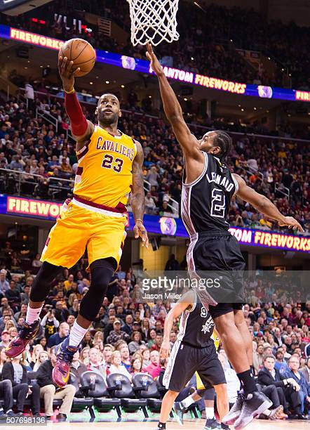 LeBron James of the Cleveland Cavaliers shoots over Kawhi Leonard of the San Antonio Spurs during the second half at Quicken Loans Arena on January...