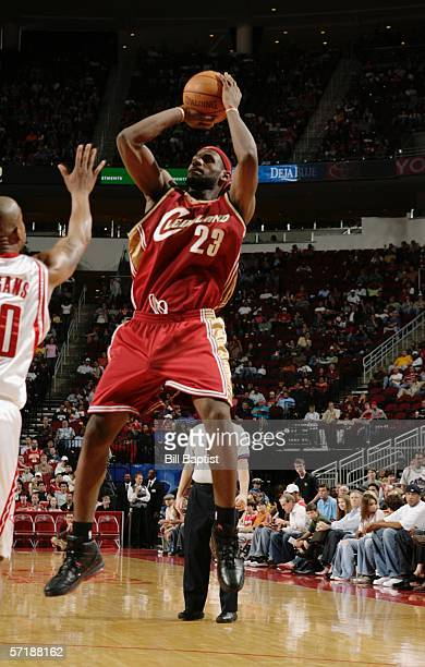 LeBron James of the Cleveland Cavaliers shoots over Keith Bogans of the Houston Rockets March 26 2006 at the Toyota Center in Houston Texas NOTE TO...