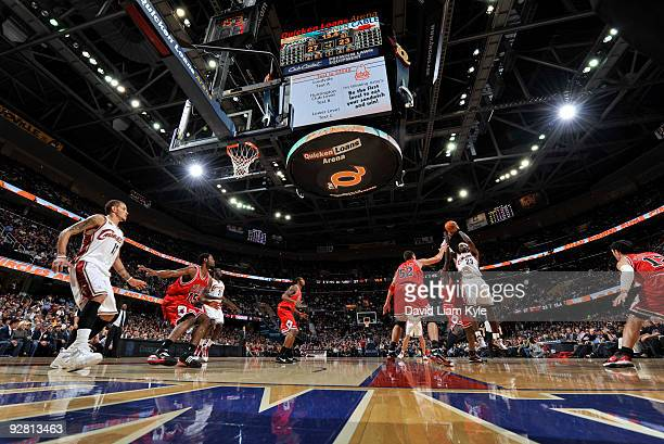 LeBron James of the Cleveland Cavaliers shoots over Luol Deng and Brad Miller of the Chicago Bulls on November 5, 2009 at The Quicken Loans Arena in...