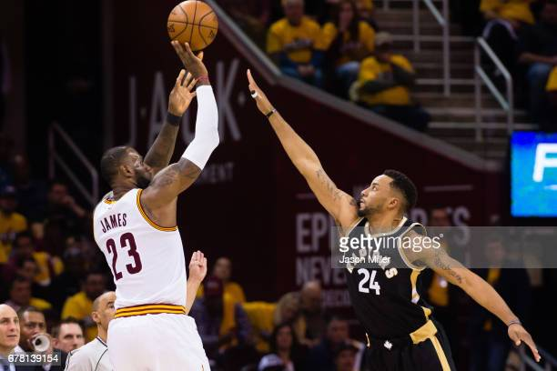 LeBron James of the Cleveland Cavaliers shoots over Norman Powell of the Toronto Raptors during the second half of Game Two of the NBA Eastern...