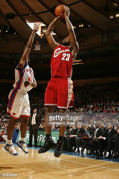 LeBron James of the Cleveland Cavaliers shoots over Qyntel Woods of the New York Knicks during the game at the Madison Square Garden on April 5 2006...