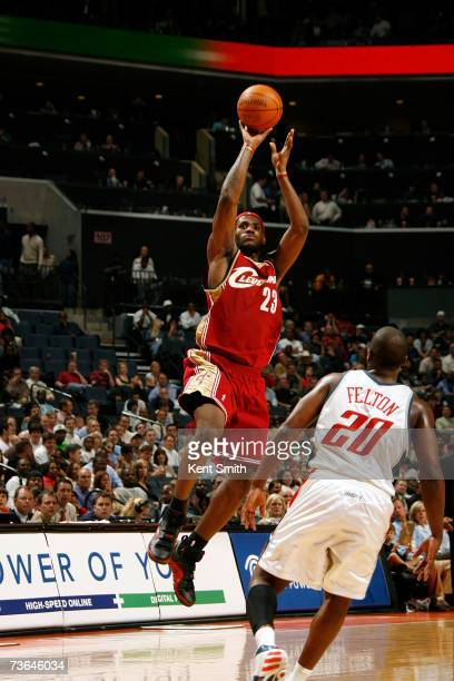 LeBron James of the Cleveland Cavaliers shoots over Raymond Felton of the Charlotte Bobcats on March 20 2007 at the Charlotte Bobcats Arena in...