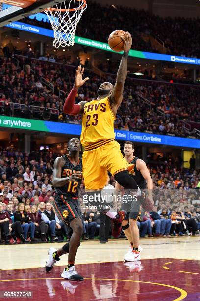 LeBron James of the Cleveland Cavaliers shoots over Taurean Prince of the Atlanta Hawks during the first half at Quicken Loans Arena on April 7 2017...